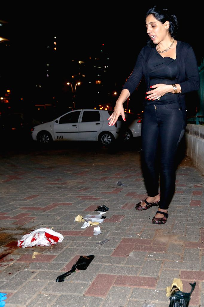 An Israeli woman reacts at the scene of a stabbing attack in Kiryat Gat, southern Israel, on Nov. 21, 2015. A suspected terrorist stabbed and wounded four ...