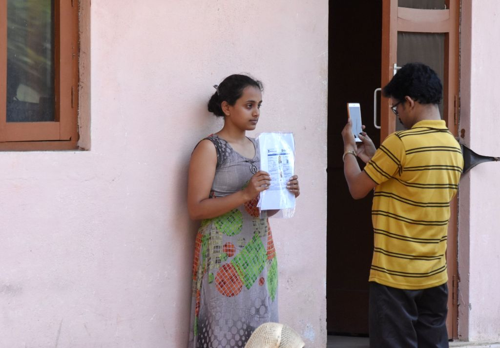 An official takes picture of an applicant before sitting for the National Eligibility cum Entrance Test NEET (UG) 2019 in Bengaluru, on May 5, 2019.