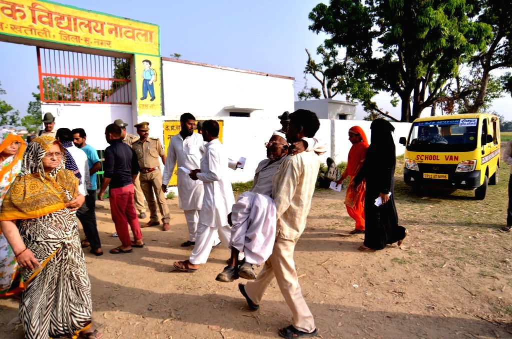 An old man being carried to a polling station to cast his vote for the 2019 Lok Sabha elections in Navala village UttarPradesh Muzaffarnagar district, on April 11, 2019.