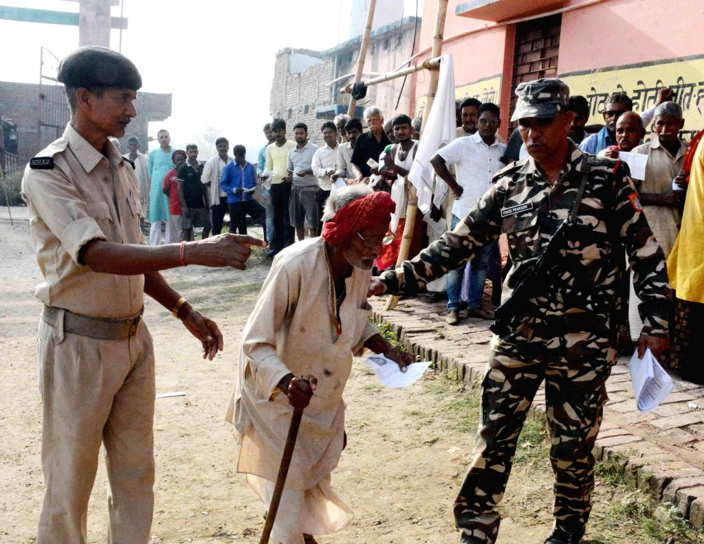 An old voter being assisted to a polling station to cast vote for the fourth phase of 2019 Lok Sabha elections, in Bihar's Munger on April 29, 2019.