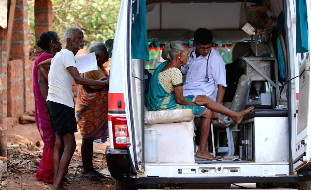 An old woman gets a medical check-up while others wait for their turn outside a Mobile OPD Van of HelpAge India - a Non Profit Organization that reaches out to the elderly in areas ...