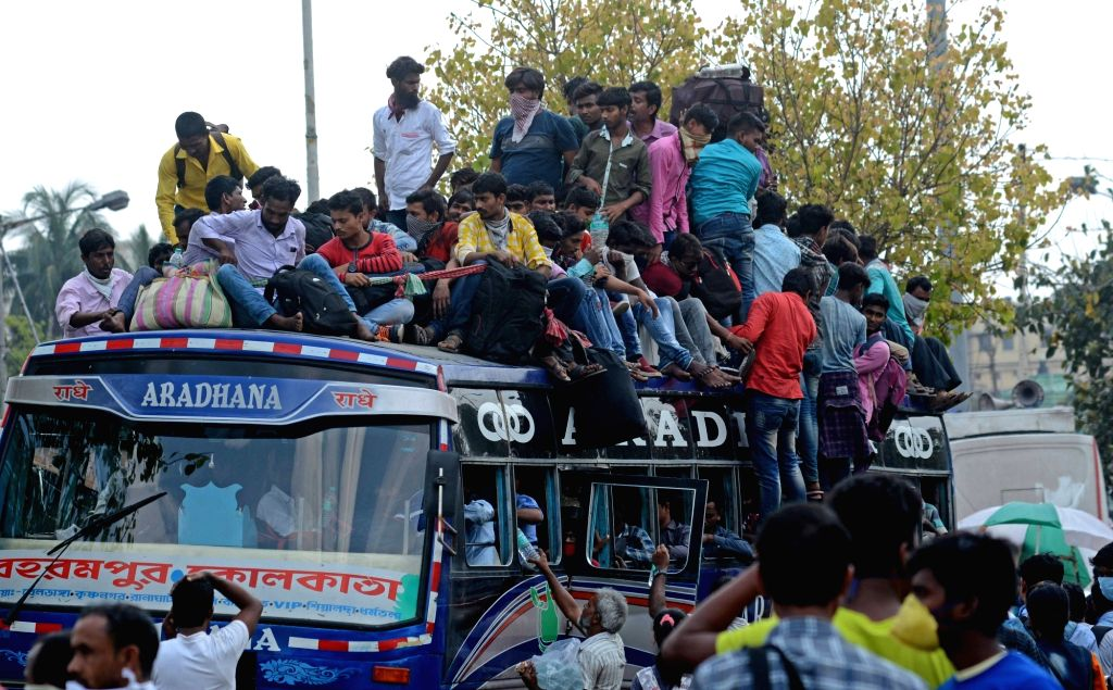 An overcrowded bus with migrant workers returning back home amid COVID-19 outbreak, seen during complete lockdown in the country in a bid to curtail the spread of coronavirus, in Kolkata on ...