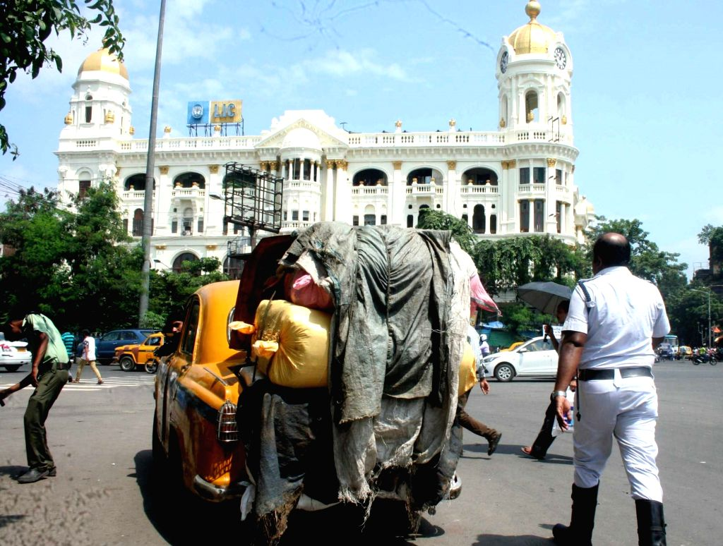 An overloaded taxi at Esplanade in Kolkata on Sept 11, 2016.