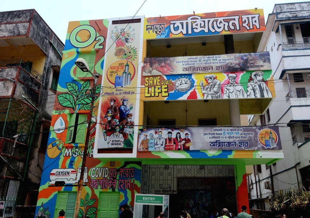 An oxygen parlour painted with COVID 19 awareness graffiti during coronavirus pandemic in Kolkata   23 May, 2021.