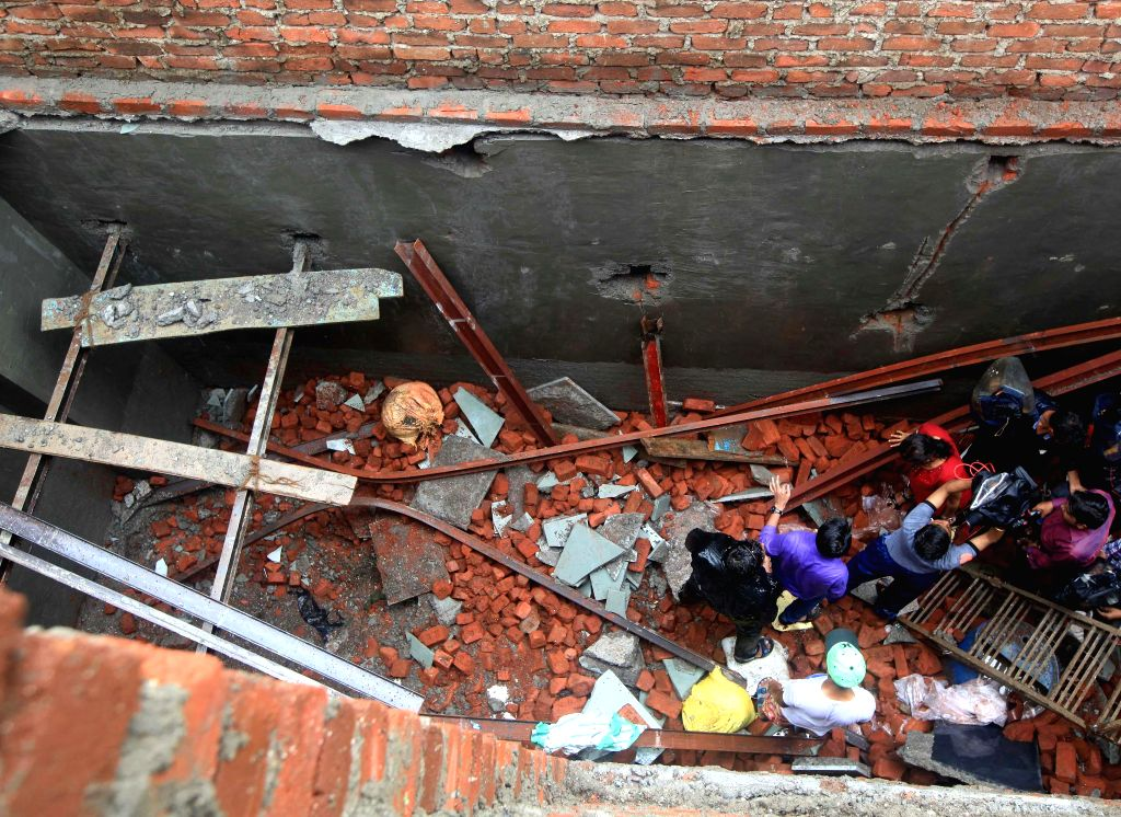 An under-construction wall collapses in Colaba of Mumbai killing one on July 12, 2014.