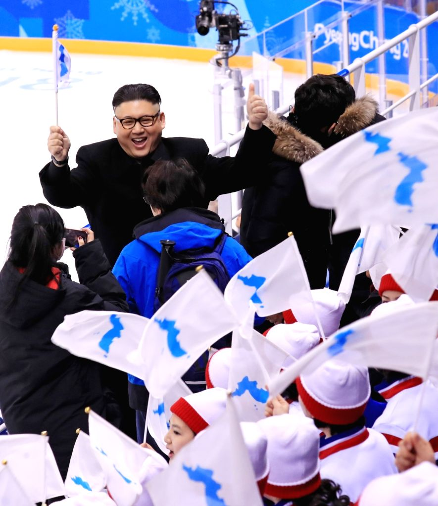 An unidentified man impersonating North Korean leader Kim Jong-un appears in front of the North Korean cheerleading squad during a Korea-Japan women's ice hockey match of the PyeongChang ...