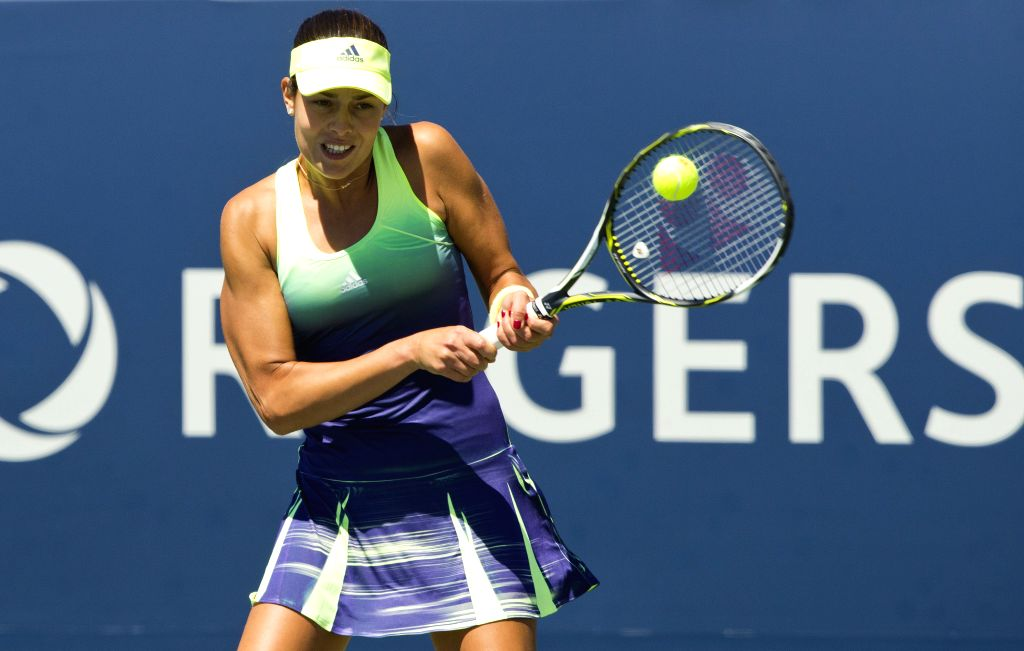 Ana Ivanovic of Serbia hits a return during the women's singles 2nd round match against Olga Govortsova of Belarus at the 2015 Rogers Cup in Toronto, Canada, on ...