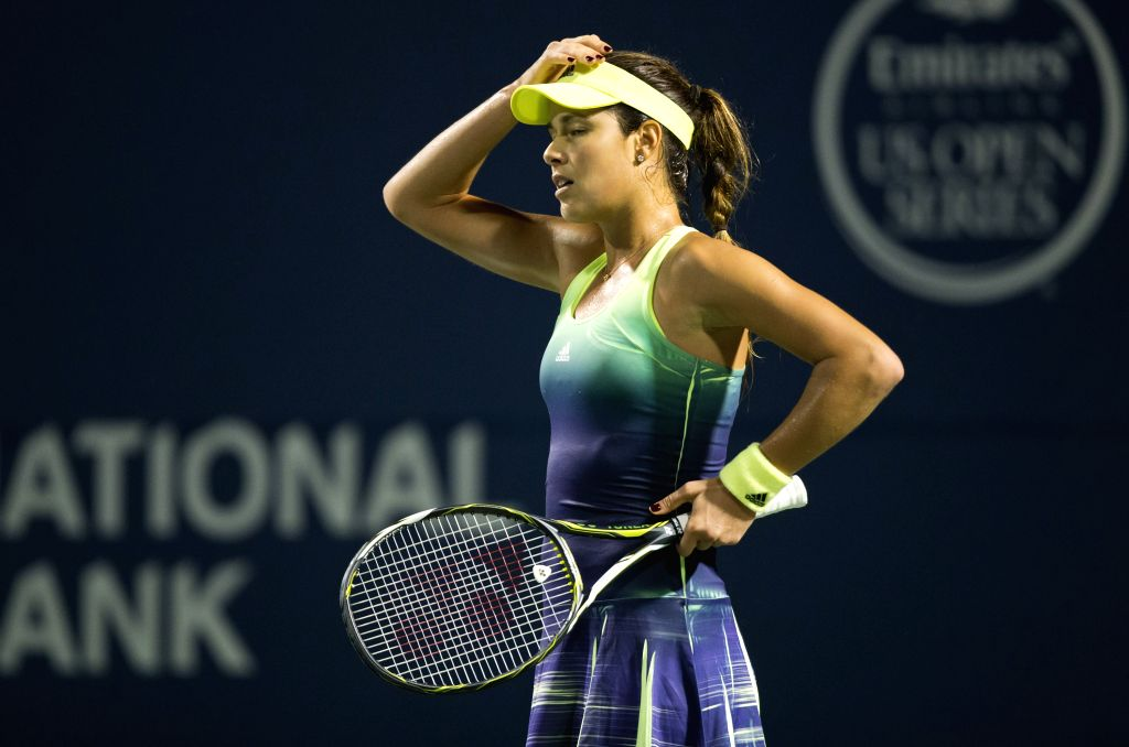 Ana Ivanovic of Serbia reacts during the quarterfinal match of women's singles against Belinda Bencic of Switerland at the 2015 Rogers Cup in Toronto, Canada, Aug. ...