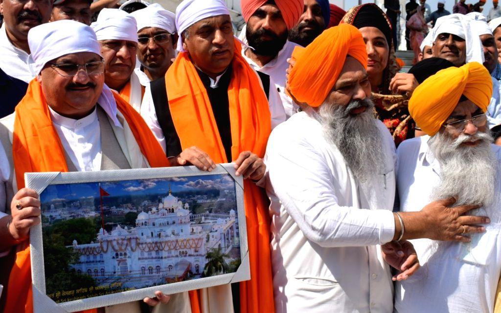 Anandpur Sahib: JBJP National Working President J.P. Nadda and Himachal Pradesh Chief Minister Jai Ram Thakur during their visit to Shri Keshgarh Sahib Gurudwara in Punjab's Anandpur Sahib, on Oct 7, ... - Jai Ram Thakur