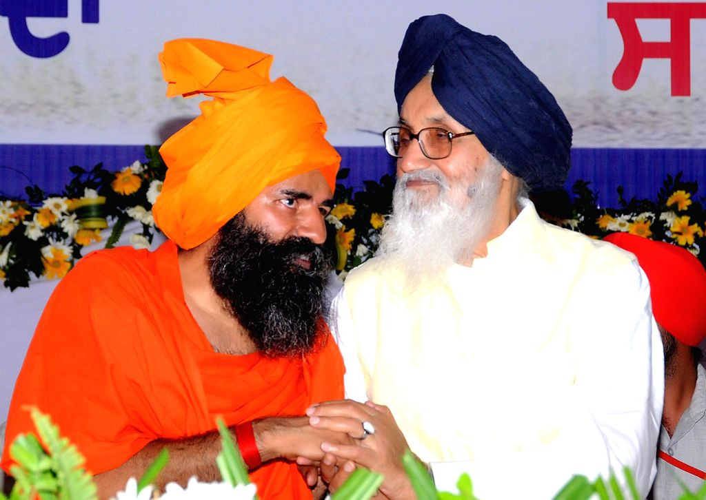 Anandpur Sahib: Punjab Chief Minister Parkash Singh Badal and Yoga Guru Ramdev addresses during a function to mark 350th foundation day of Sri Anandpur Sahib in Anandpur Sahib on June 19, 2015. - Parkash Singh Badal