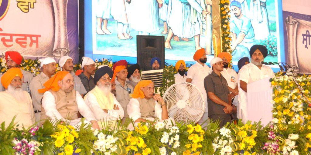 Anandpur Sahib: Punjab Deputy Chief Minister Sukhbir Singh Badal addresses during a function to mark 350th foundation day of Sri Anandpur Sahib in Anandpur Sahib on June 19, 2015. Also seen Union ... - Sukhbir Singh Badal and Parkash Singh Badal
