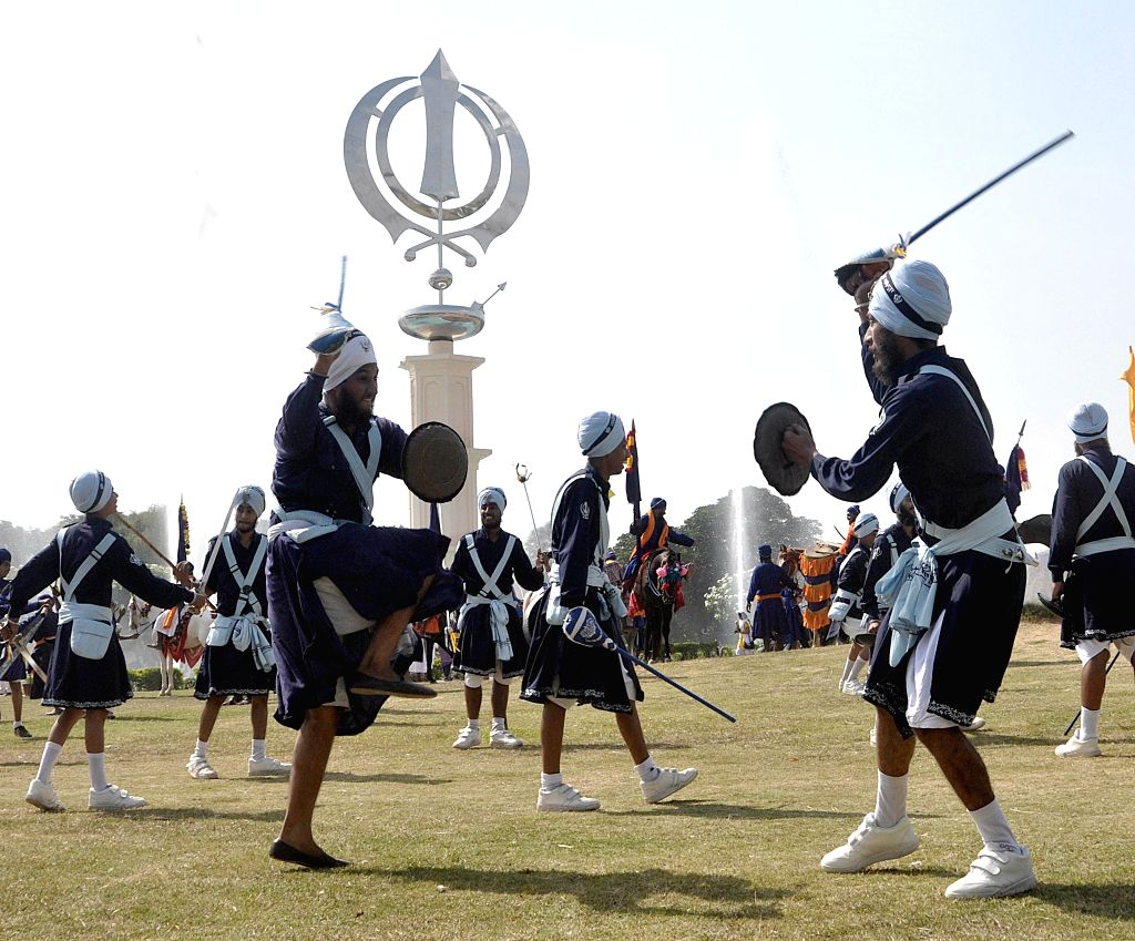Anandpur Sahib: Sikh Nihangs display their `Gatka` skills on the 350th foundation day celebrations of Sri Anandpur Sahib at Anandpur Sahib on June 17, 2015.