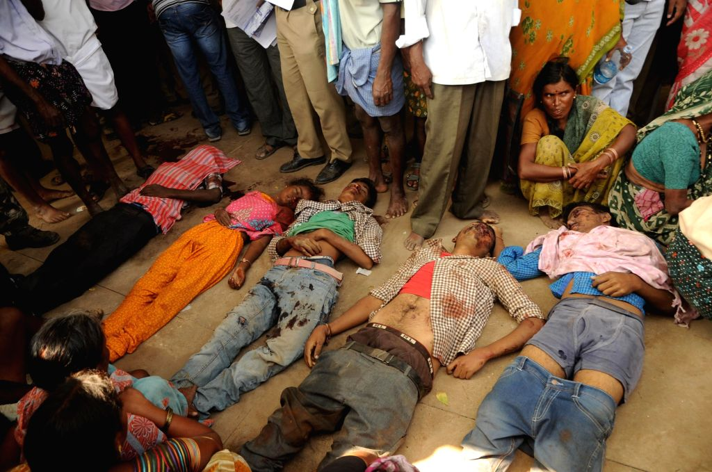 The bodies of the people who were killed in a bus accident in Andhra Pradesh's Anantapur district on Jan 7, 2015. At least 14 passengers, half of them students, were killed and 40 were ...