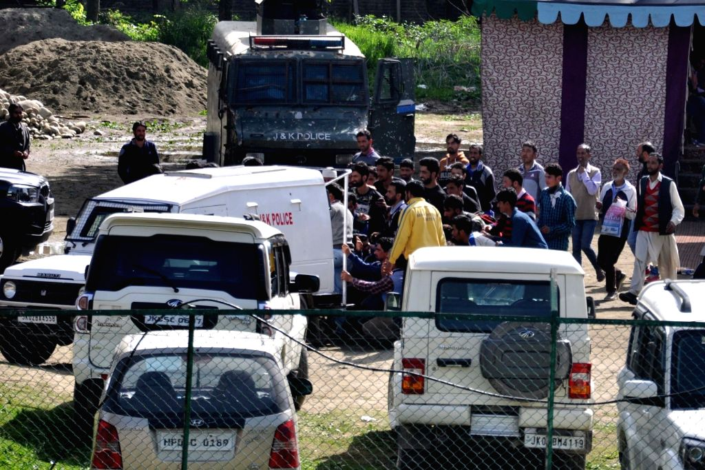 Anantnag: Jammu and Kashmir Police on Saturday ordered a probe into the use of a security vehicle for distributing food packets among BJP supporters in the state's Anantnag district after a video surfaced on social media wherein one police vehicle is