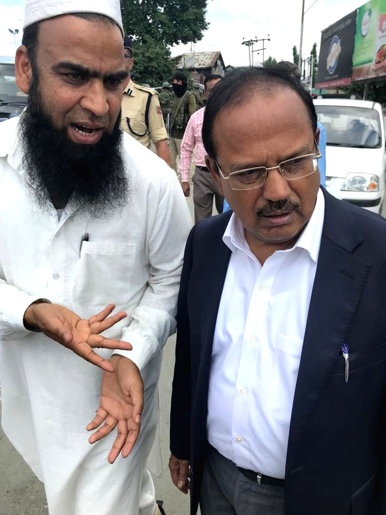 Anantnag: National Security Advisor (NSA) Ajit Doval interacts with public in Anantnag, Jammu and Kashmir on Aug, 10 2019. (Photo: IANS)