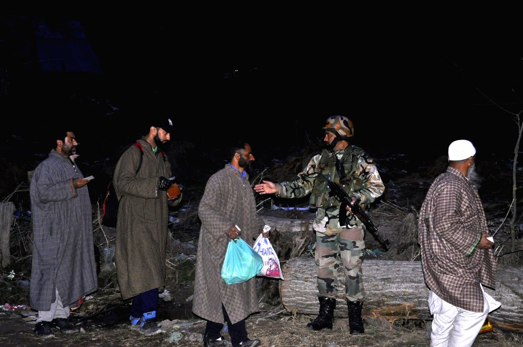 Anantnag : Security personnel carry out cordon and search operations after a National Conference block President was shot at and injured by unidentified gunmen in Jammu and Kashmir's Anantnag ...