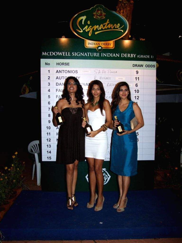 Anchor Mashoom and Parizad Kolah with friends at Mcdowell Signature Indian Derby event in Mumbai.