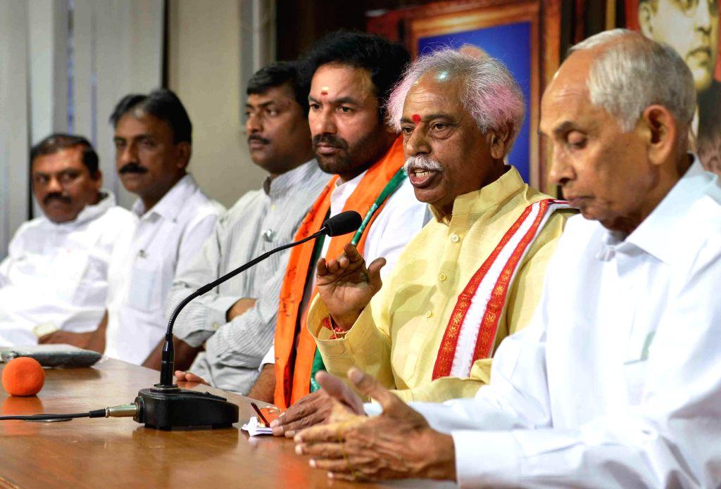 Andhra BJP chief G. Kishan Reddy, party leader Bandaru Datatiriya and others during a meeting in Hyderabad on April 11, 2014. - G. Kishan Reddy
