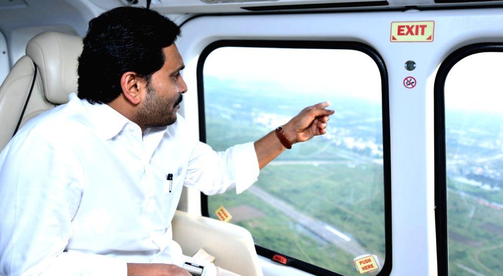 Andhra CM aerial surveys flood-hit Krishna, Guntur districts.