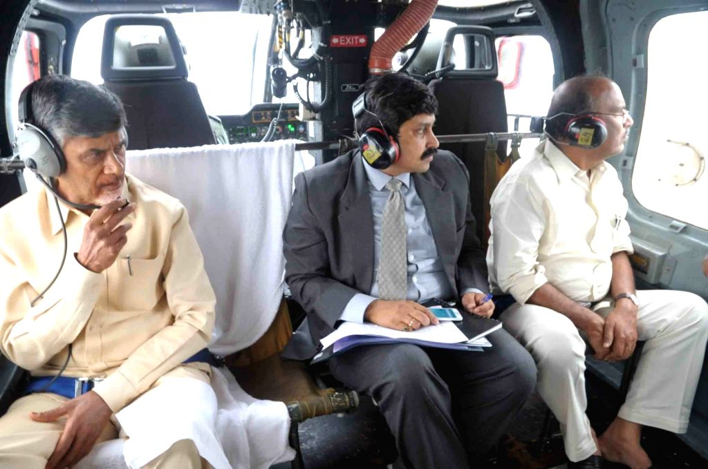Andhra Pradesh: Andhra Pradesh Chief Minister N. Chandrababu Naidu conducts aerial survey of flood affected areas of the state on Nov 18, 2015. - N. Chandrababu Naidu