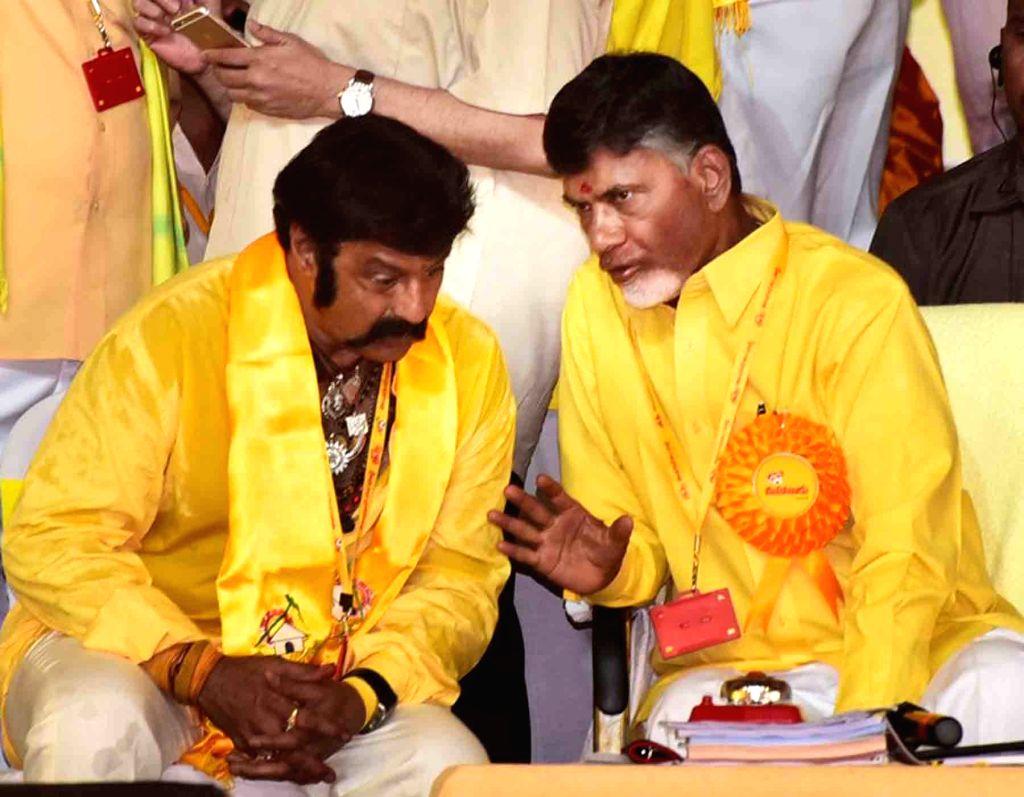 Andhra Pradesh Chief Minister and TDP chief N Chandrababu Naidu interacts with actor-turned politician Nandamuri Balakrishna during Telugu Desam Party's 'Mahanadu' -mega-convention- in ... - N Chandrababu Naidu