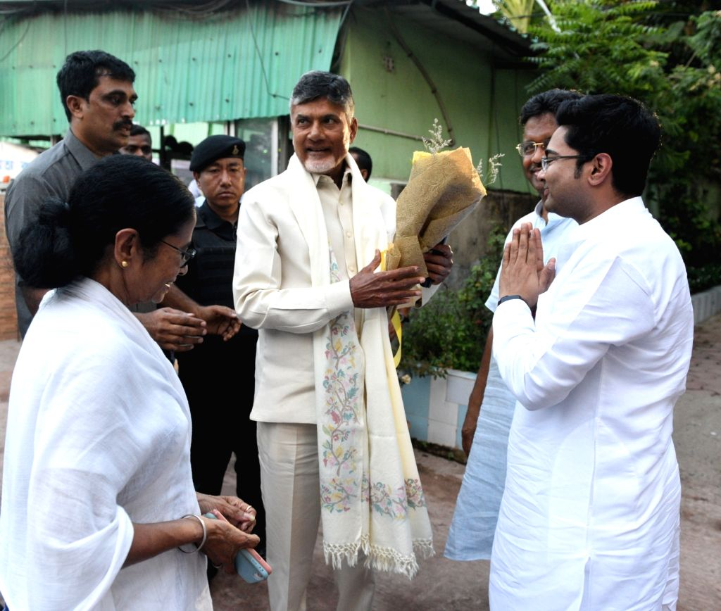 Andhra Pradesh Chief Minister and TDP President N. Chandrababu Naidu being greeted by TMC MP Abhishek Banerjee and West Bengal Cabinet Minister Firhad Hakim as West Bengal Chief Minister and ... - Firhad Hakim, N. Chandrababu Naidu, Abhishek Banerjee and Mamata Banerjee