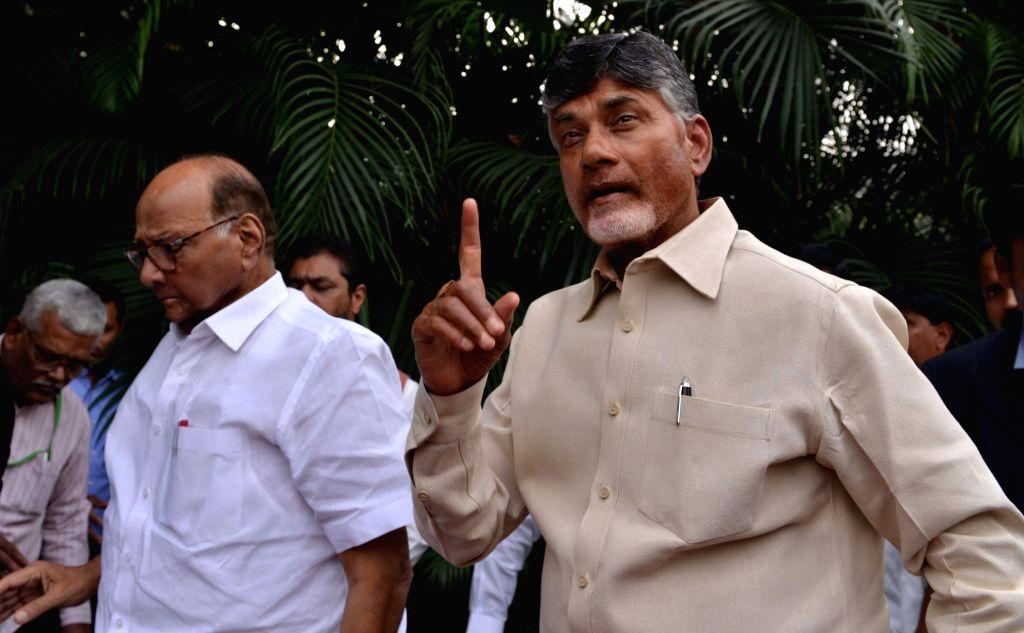 Andhra Pradesh Chief Minister and Telugu Desam Party (TDP) chief N. Chandrababu Naidu accompanied by NCP chief Sharad Pawar talks to the media in New Delhi, on Nov 1, 2018. - N. Chandrababu Naidu