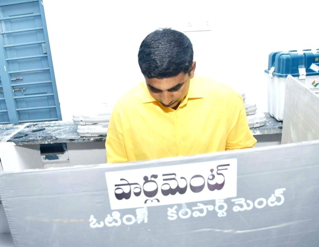 Andhra Pradesh Chief Minister and Telugu Desam Party (TDP) President N. Chandrababu Naidu's son and N. Lokesh casts his vote for the Andhra Pradesh Assembly elections, at a polling booth in Undavalli ... - N. Chandrababu Naidu