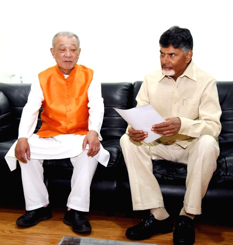 Andhra Pradesh Chief Minister Chandrababu Naidu meets World Health Organization (WHO) Goodwill Ambassador and Nippon Foundation Chairman Yohei Sasakawa at Undavalli, in Andhra Pradesh's ... - Chandrababu Naidu