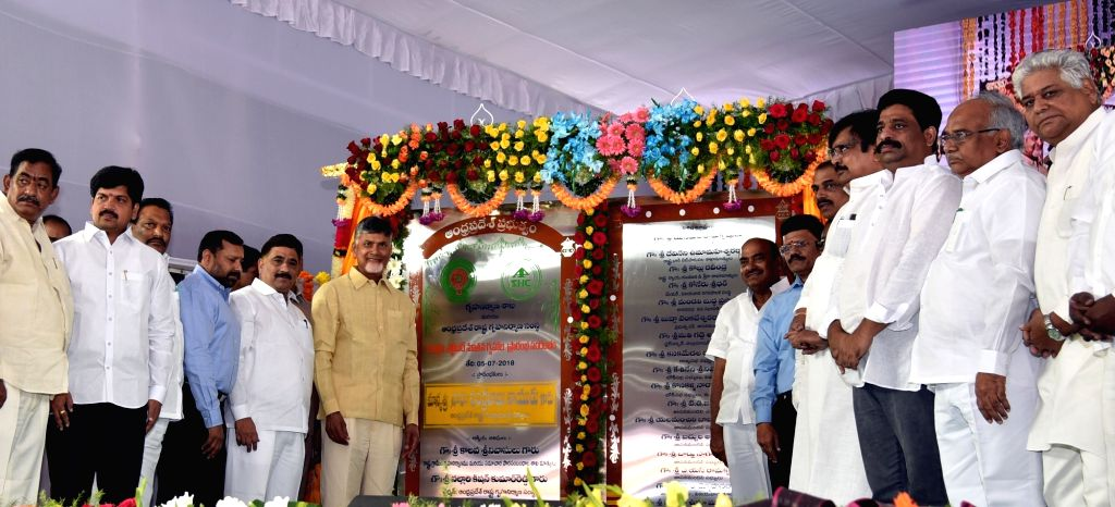 Andhra Pradesh Chief Minister Chief Minister N. Chandrababu Naidu unveils the plaque to inaugurate three lakh houses under the NTR Housing Scheme at IGM Stadium in Vijayawada on July 5, ... - Chief Minister N. Chandrababu Naidu
