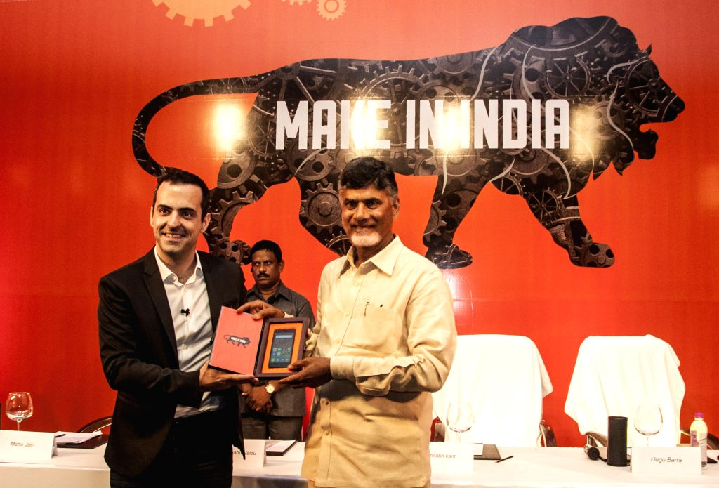 Andhra Pradesh Chief Minister N. Chandrababu and VP Global Xiaomi Hugo Barra during the announcement of Chinese low-cost smartphone manufacturer Xiaomi`s first make in India smartphone ... - N. Chandrababu