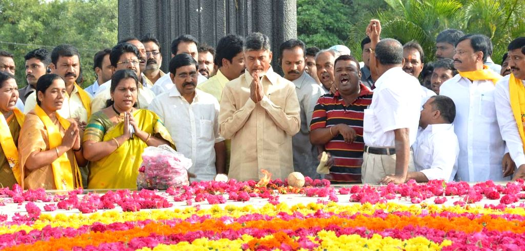 Andhra Pradesh Chief Minister N. Chandrababu Naidu pays tribute to Nandamuri Taraka Ramarao at NTR Ghat in Hyderabad on Aug 18, 2014. - N. Chandrababu Naidu
