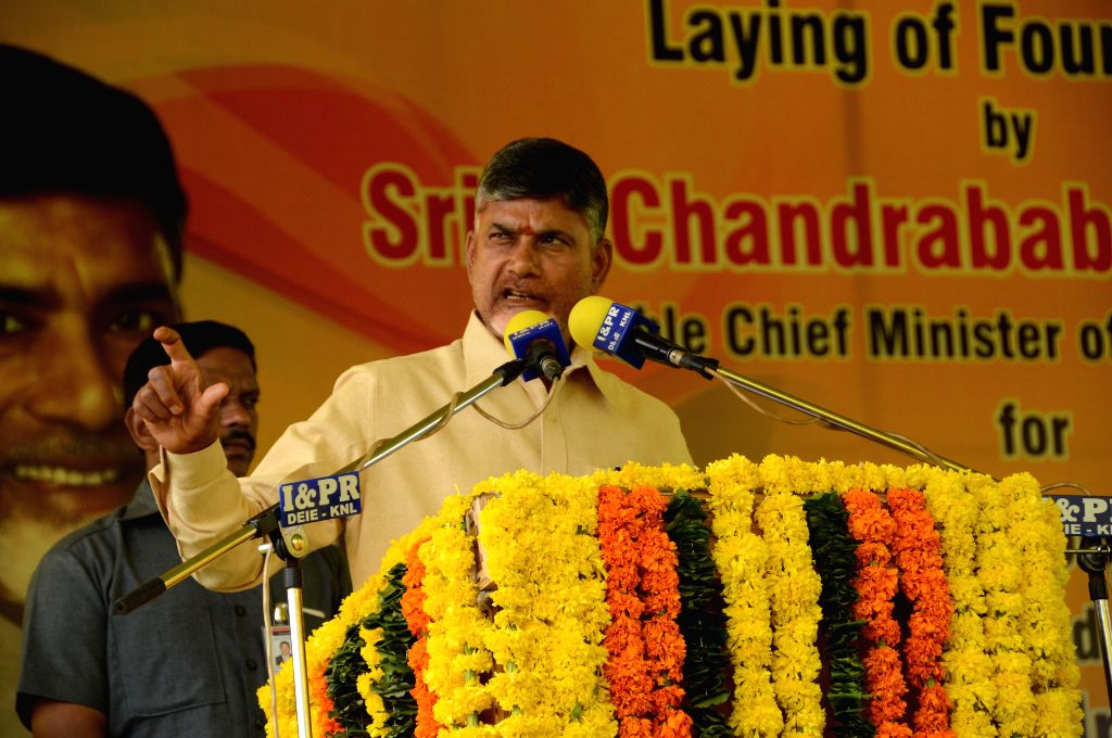 Andhra Pradesh Chief Minister N. Chandrababu Naidu addresses during a programme organised to lay the foundation stone of a Food Park in Kurnool district of the state on Aug 17, 2015. - N. Chandrababu Naidu