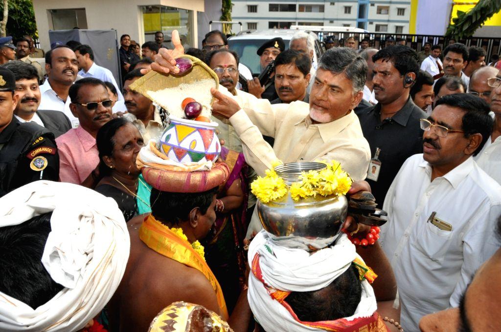 Andhra Pradesh Chief Minister N. Chandrababu Naidu flies a kite on the eve of Makar Sankranti in Vijayawada, Andhra Pradesh on Jan 14, 2016. - N. Chandrababu Naidu