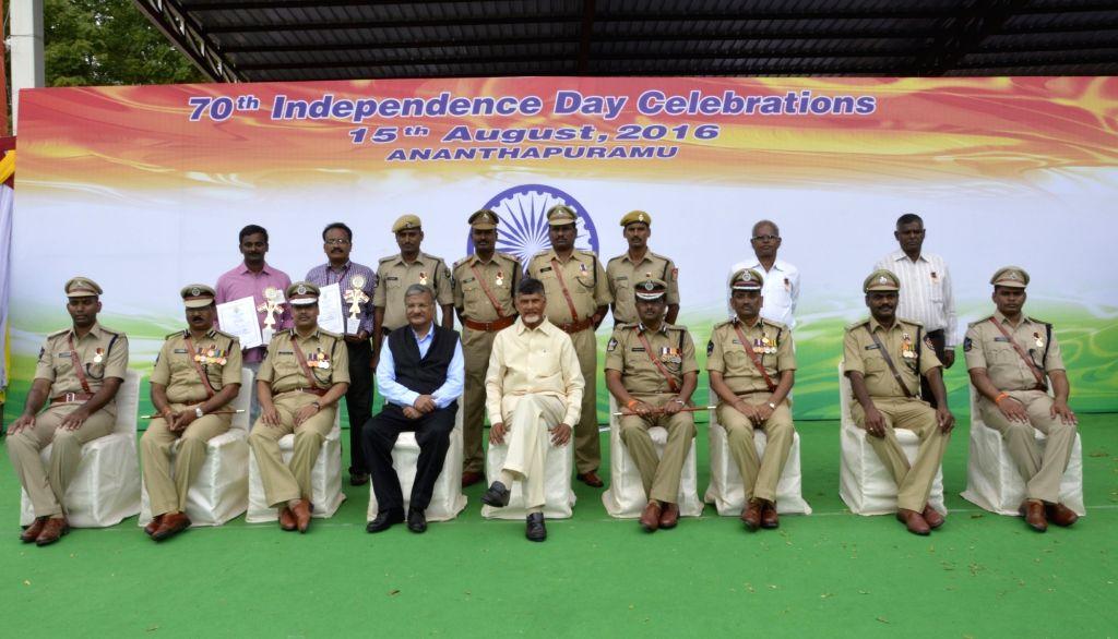 Andhra Pradesh Chief Minister N. Chandrababu Naidu with policemen who won police awards on Independence Day in Vijayawada on Aug 15, 2016. - N. Chandrababu Naidu
