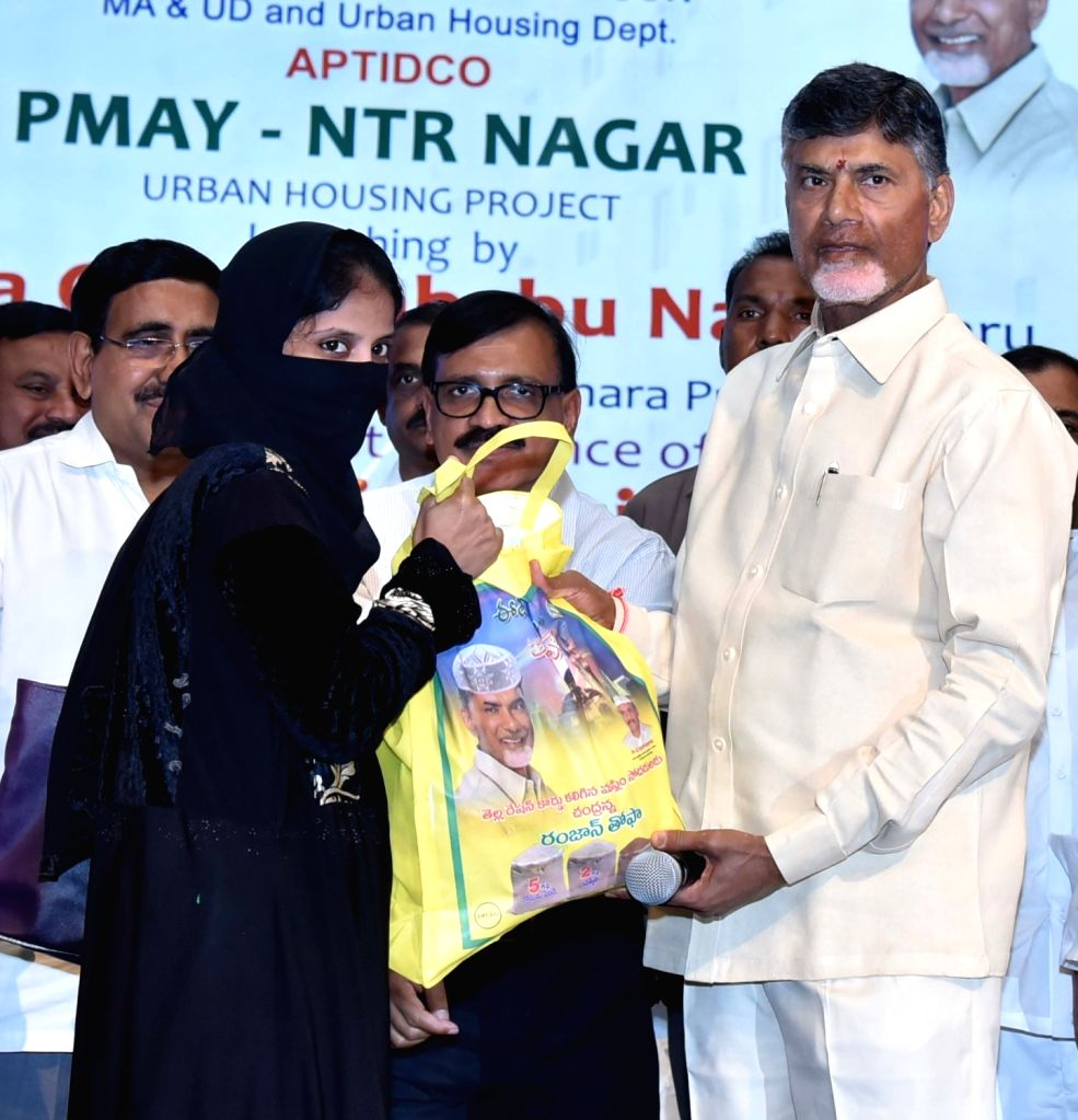 Andhra Pradesh Chief Minister N Chandrababu Naidu give away Ramzan gift packets to Muslims in Vijayawada on June 19, 2017. - N Chandrababu Naidu