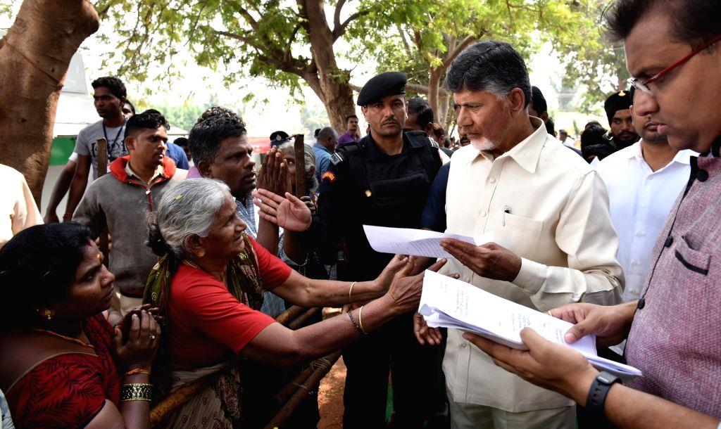 Andhra Pradesh Chief Minister N. Chandrababu Naidu listens to public grievances in Naravaripalle village of state's Chittoor district on Jan 15, 2018. - N. Chandrababu Naidu