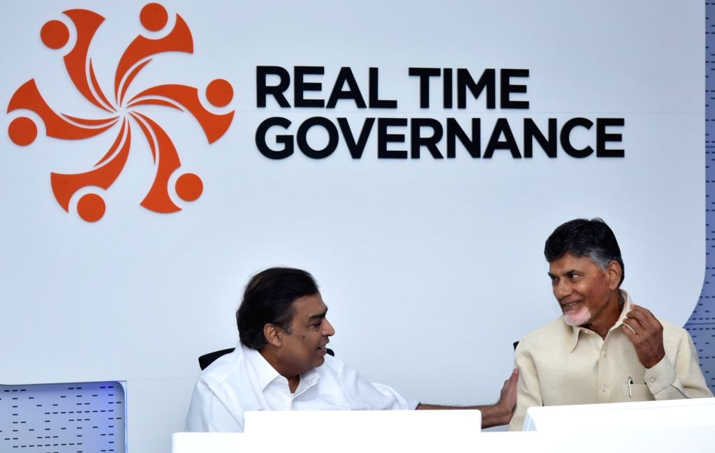 Andhra Pradesh Chief Minister N Chandrababu Naidu and Reliance Industries Ltd (RIL) Chairman Mukesh Ambani at the newly inaugurated Real Time Governance (RTG) state centre in the first ... - N Chandrababu Naidu and Mukesh Ambani