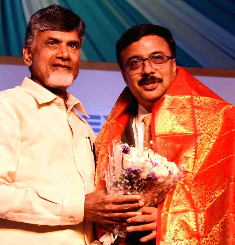 Andhra Pradesh Chief Minister N. Chandrababu Naidu and Ashok Leyland MD and CEO Vinod K Dasari during the foundation stone laying ceremony of the company's new bus plant in Vijayawada on ... - N. Chandrababu Naidu