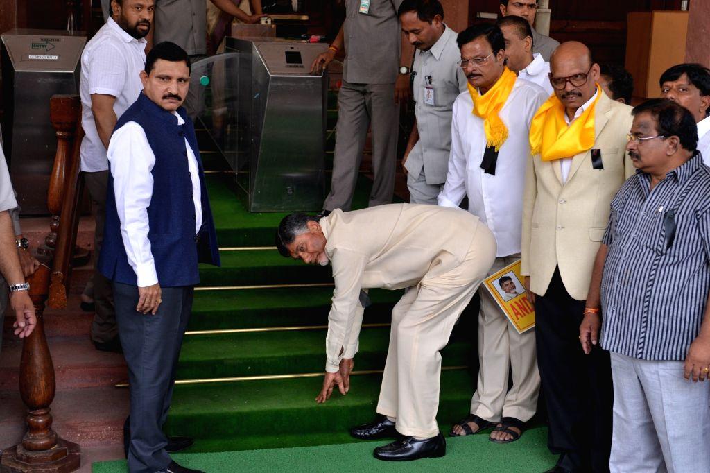 Andhra Pradesh Chief Minister N. Chandrababu Naidu touches the steps as he enters Parliament in New Delhi on April 3, 2018. - N. Chandrababu Naidu