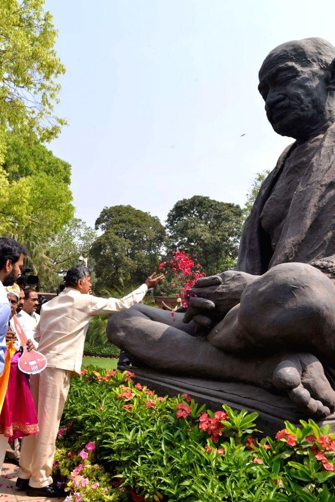 Andhra Pradesh Chief Minister N. Chandrababu Naidu pays tributes to Mahatma Gandhi at Parliament in New Delhi on April 3, 2018. - N. Chandrababu Naidu