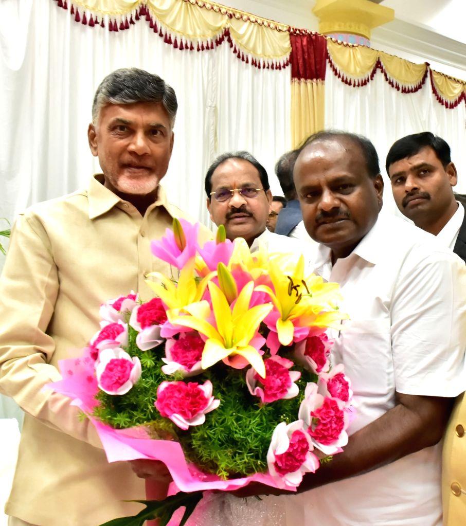 Andhra Pradesh Chief Minister N. Chandrababu Naidu with Karnataka Chief Minister H.D.Kumaraswamy at the latters swearing in ceremony in Bengaluru on May 23, 2018. - N. Chandrababu Naidu