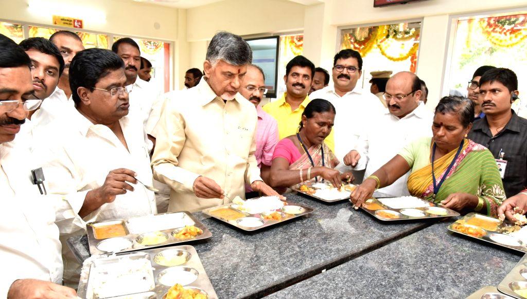 Andhra Pradesh Chief Minister N. Chandrababu Naidu has food with the people during the inauguration ofAnnapurna canteen, in Vijayawada on July 11, 2018. - N. Chandrababu Naidu