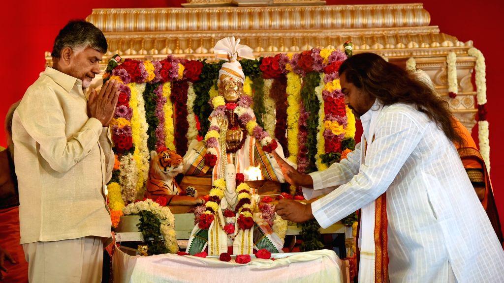 Andhra Pradesh Chief Minister N. Chandrababu Naidu offers prayers at Pavitra Sangam - the confluence of rivers Krishna and and Godavari rivers at Ibrahimpatnam near Vijayawada, on Jan 21, ... - N. Chandrababu Naidu