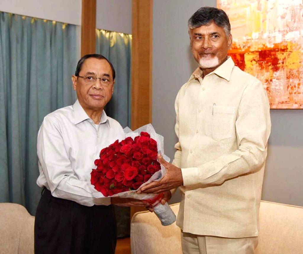 Andhra Pradesh Chief Minister N. Chandrababu Naidu greets Chief Justice of India Justice Ranjan Gogoi who laid the foundation stone for a permanent complex of the Andhra Pradesh High Court and ... - N. Chandrababu Naidu