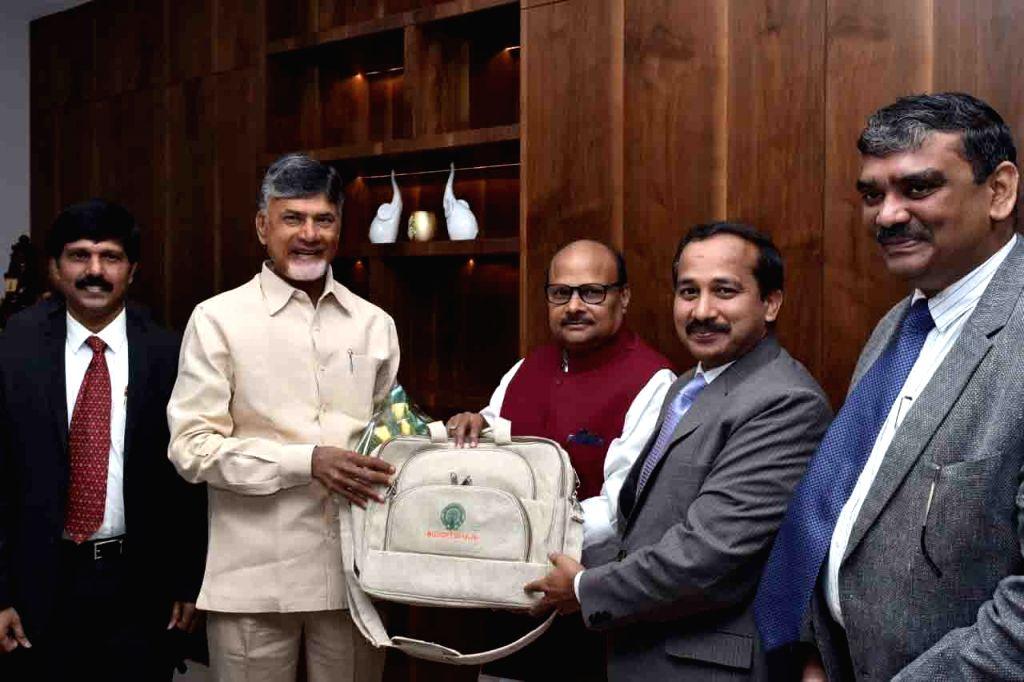 Andhra Pradesh Chief Minister N. Chandrababu Naidu with state Finance Minister Y. Ramakrishnudu ahead of the presentation of Vote on Account budget at the state assembly, in Vijayawada on ... - N. Chandrababu Naidu
