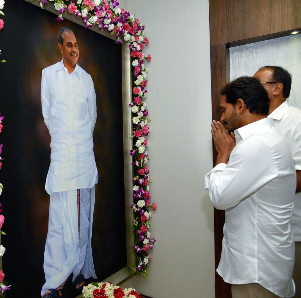 Andhra Pradesh Chief Minister Y.S. Jagan Mohan Reddy pays tributes to his father Y. S. Rajasekhara Reddy after occupying his office in the State Secretariat in Amaravati, on June 8, 2019. ... - Y.