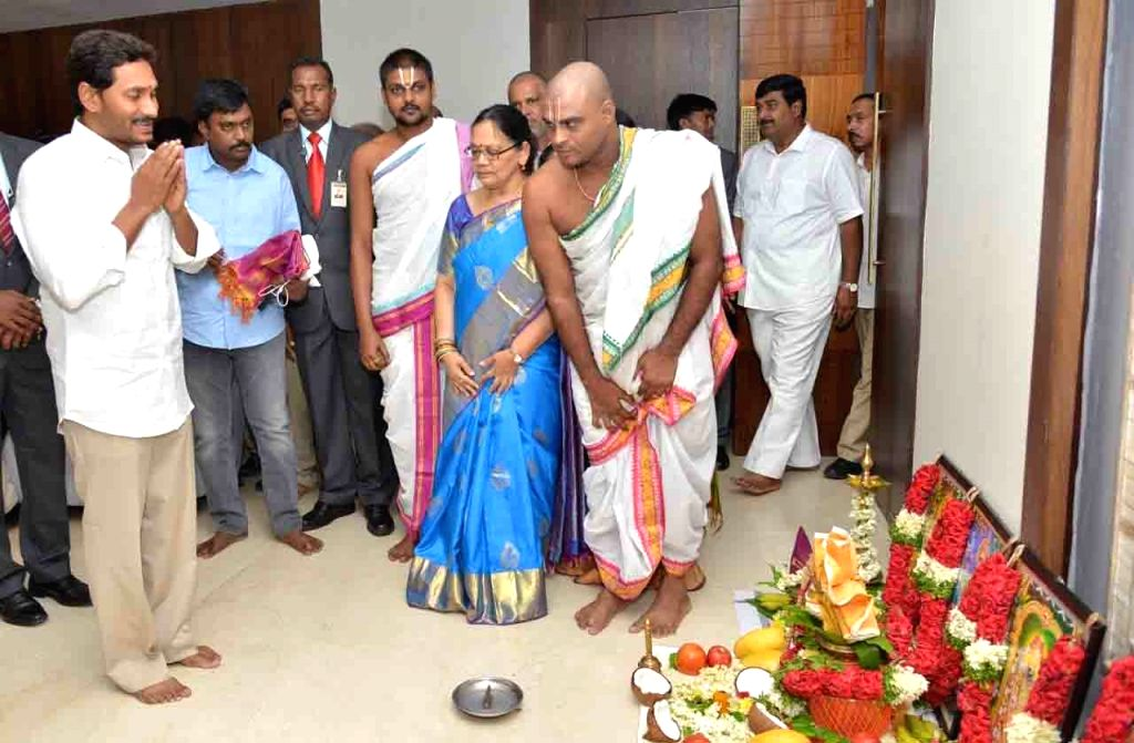 Andhra Pradesh Chief Minister Y.S. Jagan Mohan Reddy offers prayers after occupying office in the State Secretariat in Amaravati, on June 8, 2019. Jagan, as the Chief Minister is popularly ... - Y.