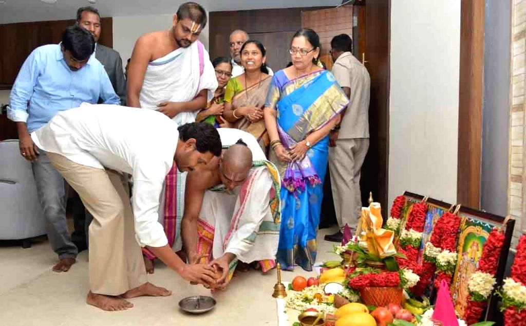 Andhra Pradesh Chief Minister Y.S. Jagan Mohan Reddy performs rituals after occupying office in the State Secretariat in Amaravati, on June 8, 2019. Jagan, as the Chief Minister is ... - Y.