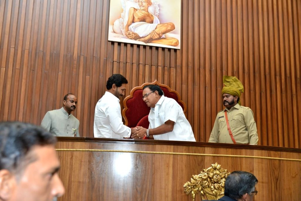 Andhra Pradesh Chief Minister Y.S. Jagan Mohan Reddy greets Pro tem Speaker C. Appala Naidu during the the first session of new State Assembly, in Amaravati on June 12, 2019. - Y. and C. Appala Naidu